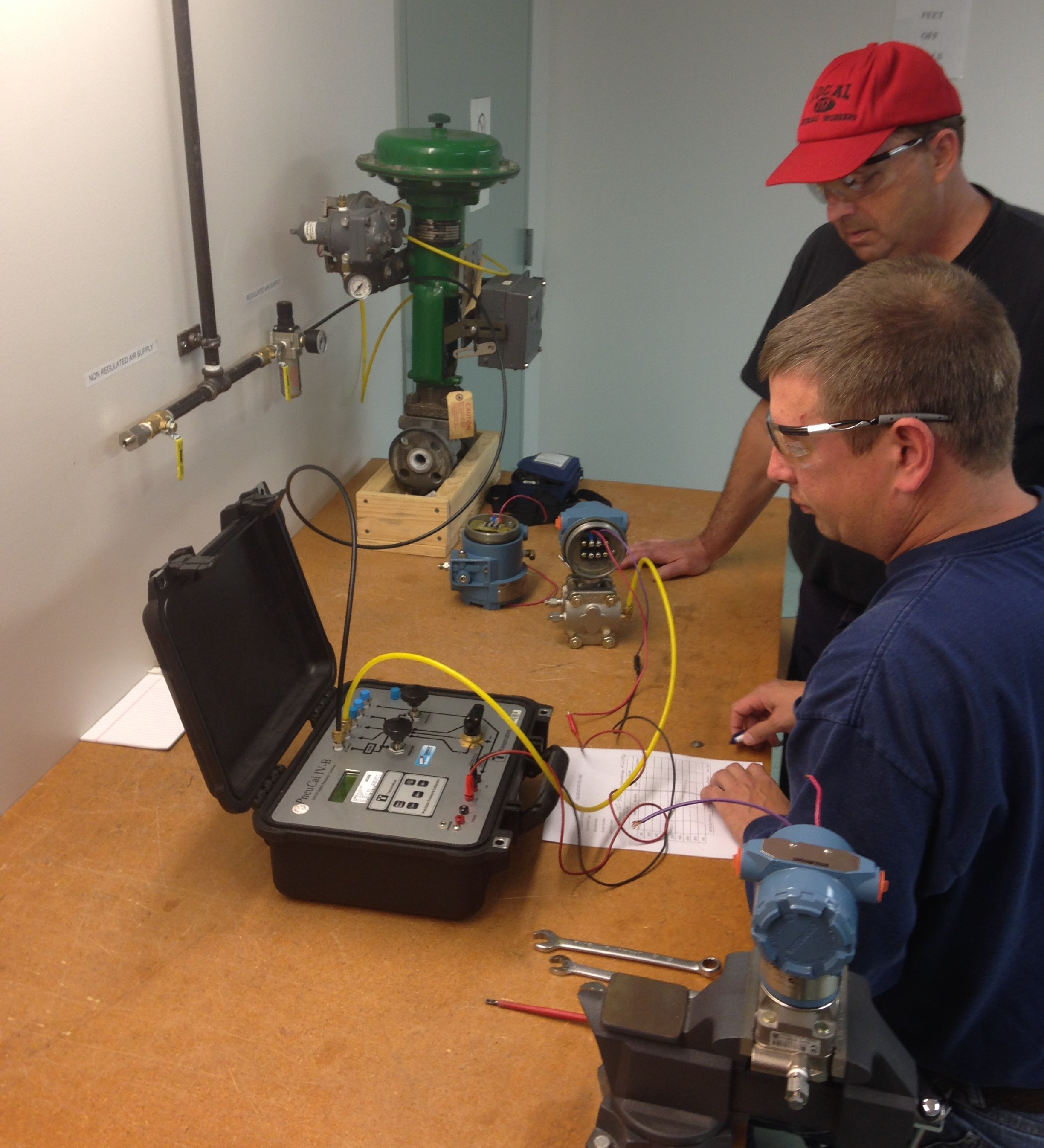 Apprentices being trained at the NECA/IBEW Electrical JATC. Applicants can expect similar training.